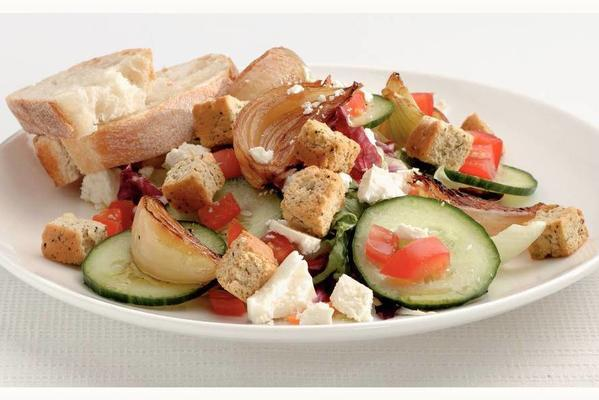 fresh salad with white cheese and croutons
