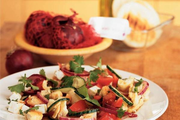 summer salad with bread and white cheese