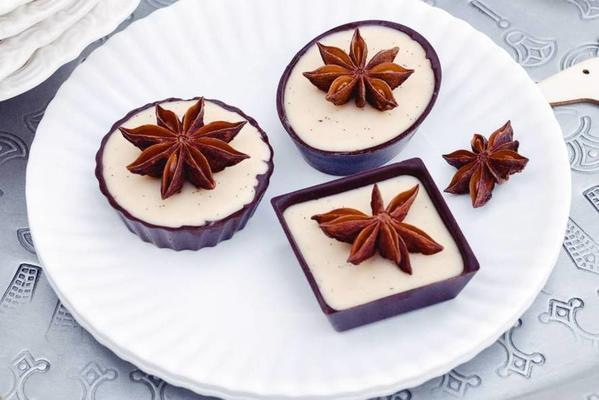 panna cotta with rum and star anise in chocolate cups