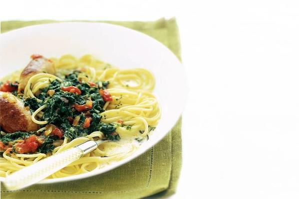 pasta with spinach cream sauce and spicy sausage