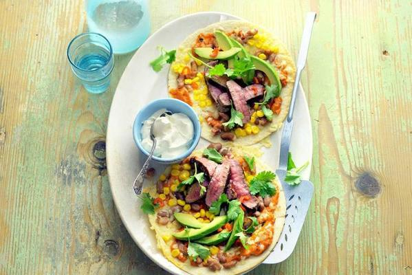 tortilla pizzas with steak, avocado and corn