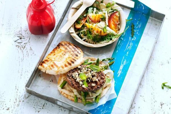 hamburger with grilled vegetables, hummus and white cheese