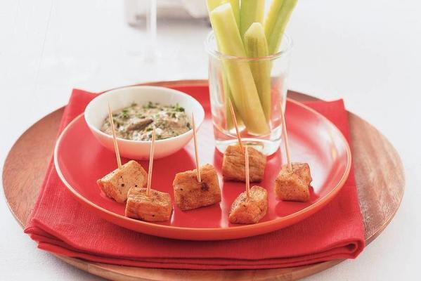 veal skewer and cucumber bars with parsley dip