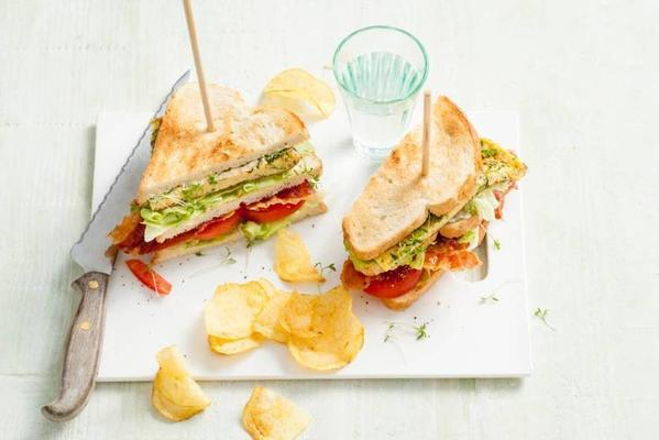 club sandwich with omelette, parmesan and fresh herbs