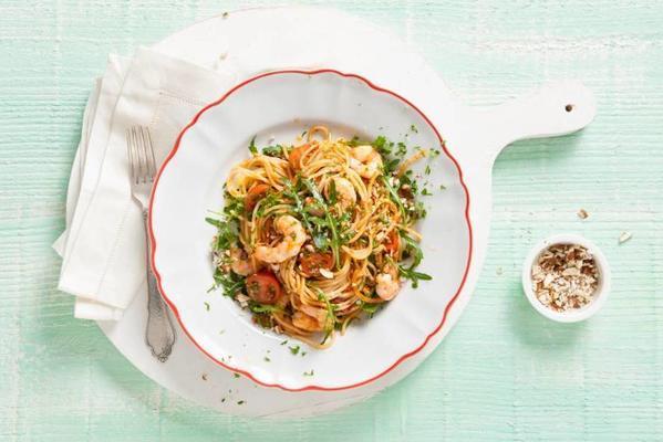 spaghetti with almond tomato pesto, lemon and shrimps