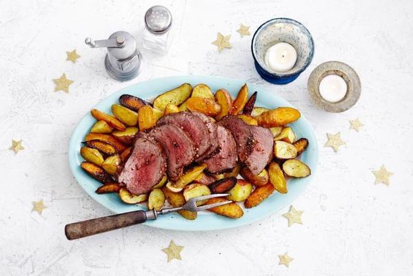 deer fillet with herb rub and roasted potato and carrot