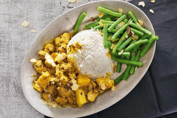 homemade chicken curry with pineapple and almonds