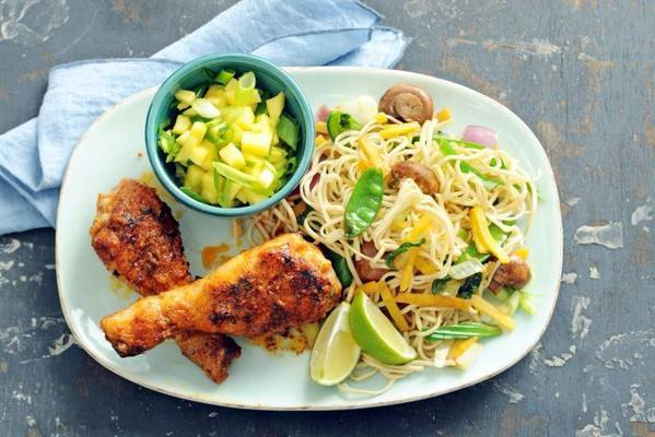 spiced drumsticks with mango salsa and noodles