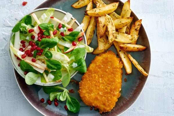 chicken schnitzel with chicory salad and oven potatoes