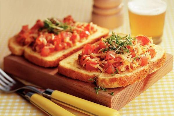 open sandwich with melted cheese and tomato