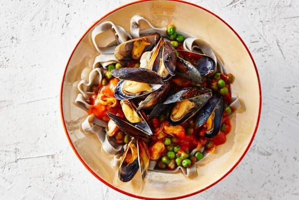 black tagliatelle with mussels in tomato sauce