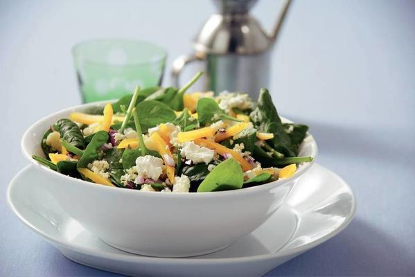 spinach salad with white cheese cubes
