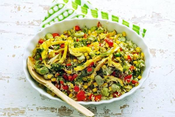 rice salad with omelette strips and basil oil