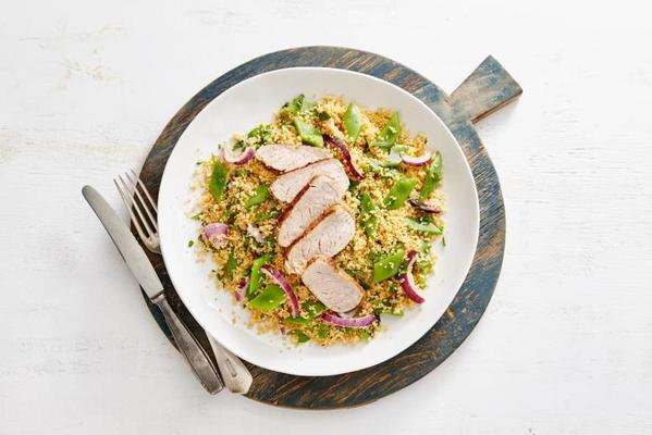grilled pork tenderloin and spicy couscous with string beans and onion