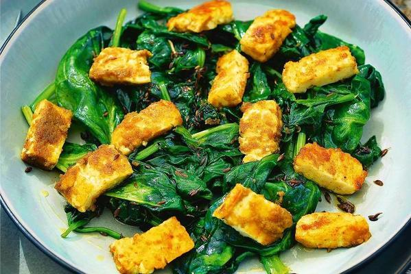pascale naessens' halloumi with curry and cumin spinach