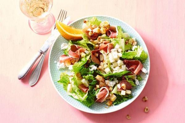 summer salad with pear, serrano ham and celeriac