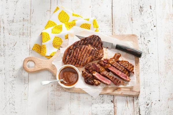 julius jaspers' ribeye from the barbecue with steak sauce