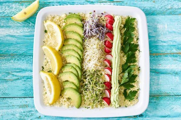 couscous salad with goat's cheese, avocado and sprouts