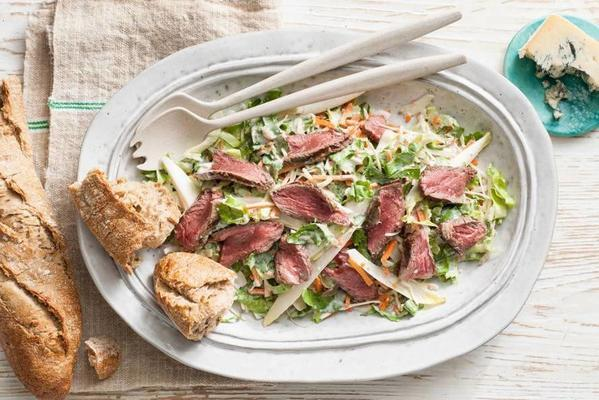 salad with tender steak strips and cheese dressing