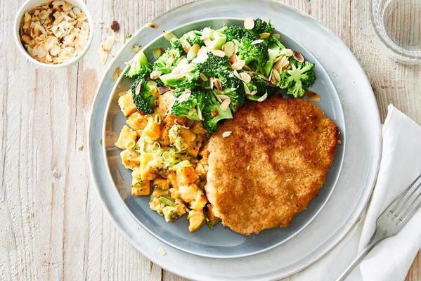 crispy schnitzel with sweet potato gratin and broccoli