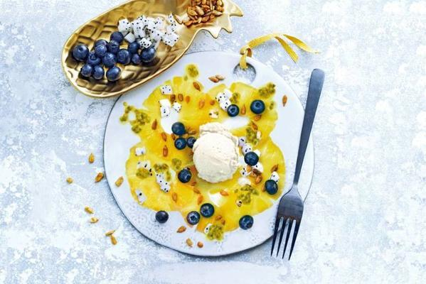 ananascarpaccio with tropical fruit and sorbet ice