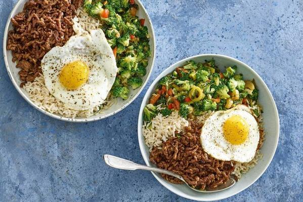 asian stir-fry with spicy minced meat, vegetables and fried egg