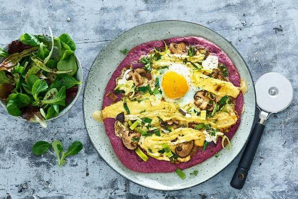 beet pizza with mushrooms, french cheese and fried egg
