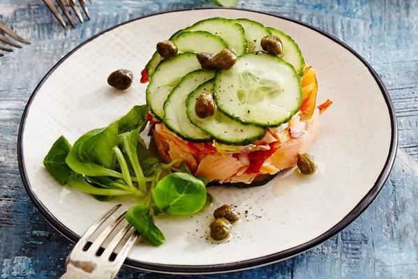 warm smoked salmon tartare with caper vinaigrette and lamb's lettuce