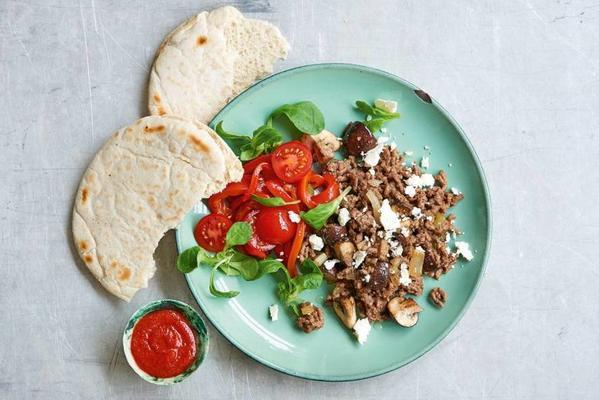 pita with spiced minced meat and paprika tomato salad