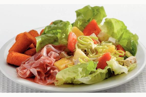 tropical fruit salad with white cheese and raw ham