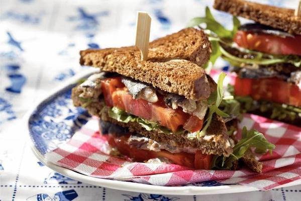 club sandwich with tomato and sardines