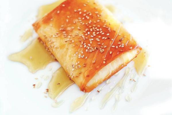 filo pastry packages with white cheese cubes and honey