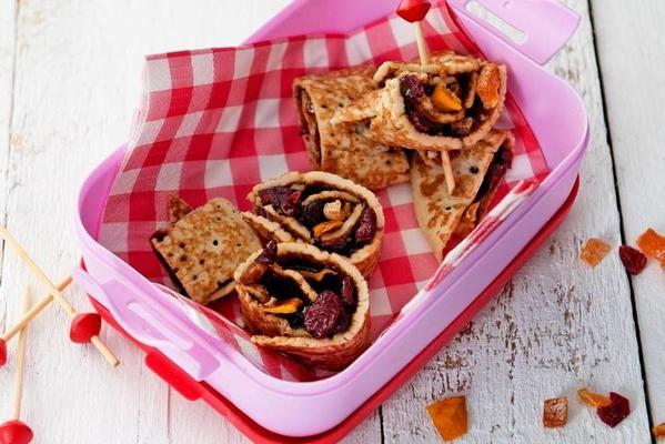 pancake rolls with apple syrup and dried fruit