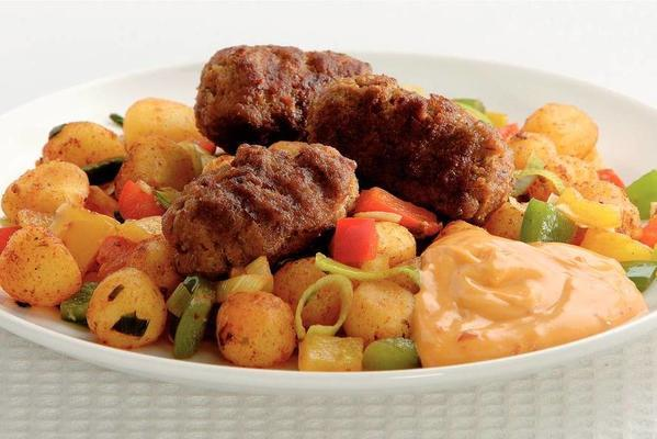 kebabs and stir-fried peppers with potatoes