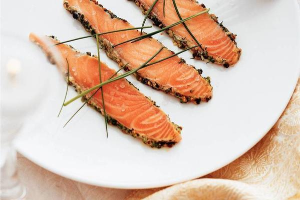 salmon cooked on board in dill-chive marinade