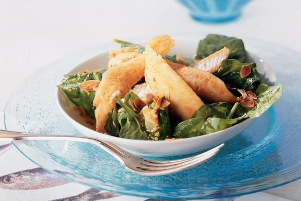 spinach salad with slippingong and orange dressing