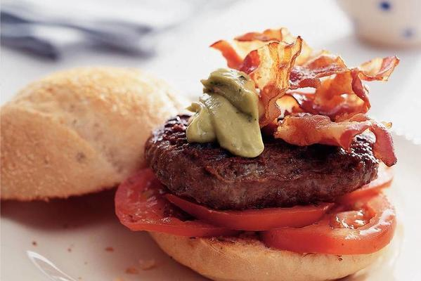 hamburger with bacon, avocado dip and tomato