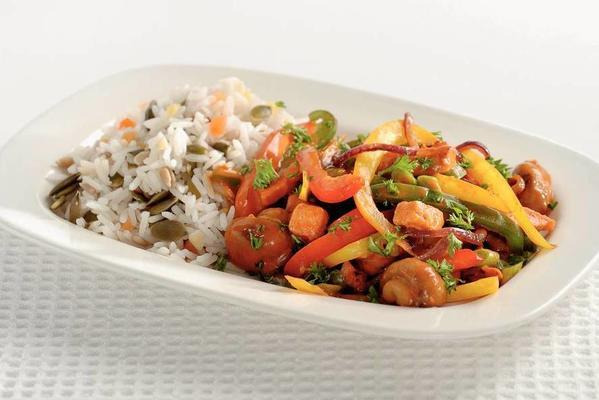 stroganoff dish with vegetables and nut rice
