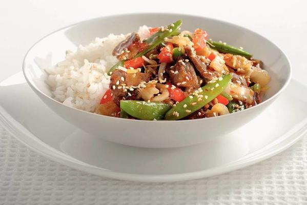 Chinese wok meat with vegetables and rice