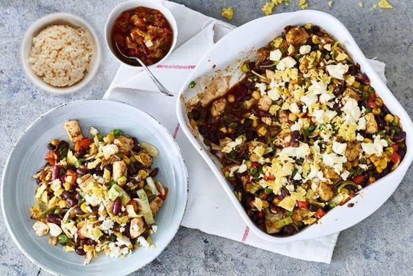 Mexican dish with chicken, vegetables and salsa