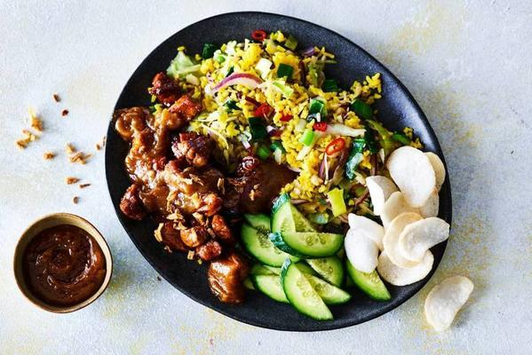thai rice stir-fry with vegetables, marinated pork and satay sauce
