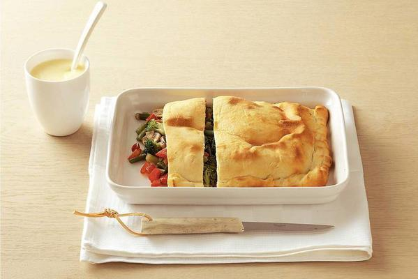 vegetable pie with cheese sauce
