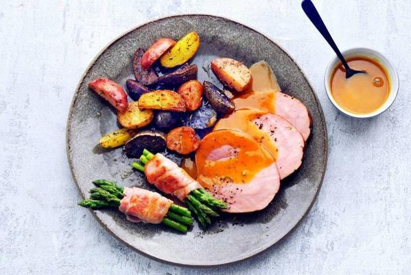 ham with oven potatoes and asparagus in bacon