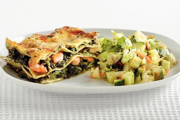 green lasagne with shrimps and pesto sauce