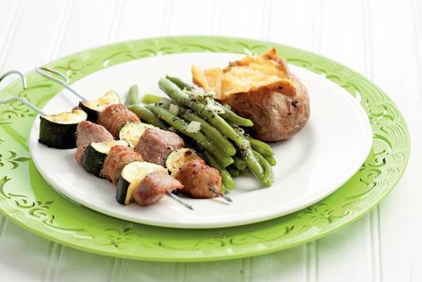 meat skewer with pesto bean salad
