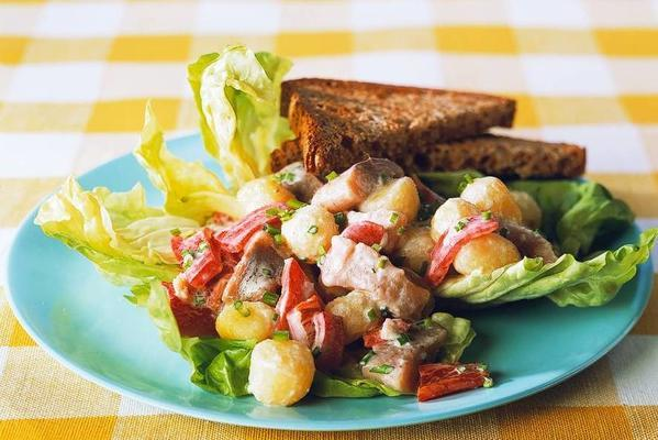 potato salad with herring and paprika