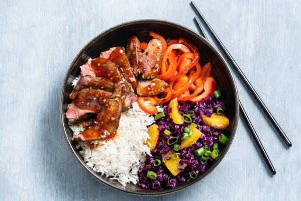 spicy stir-fry of steak with red cabbage salad and rice
