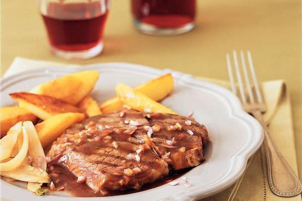 ribeye with red wine sauce, baked potatoes and chicory