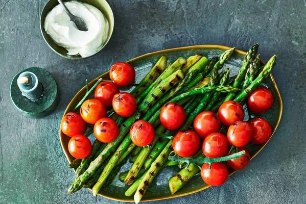 green asparagus with roasted cherry tomatoes and fresh yoghurt