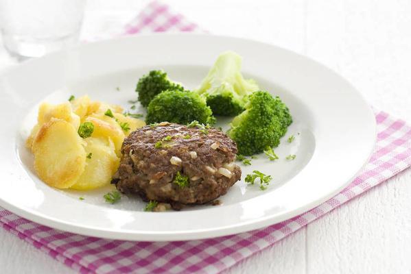 hamburgers with baked potatoes and broccoli